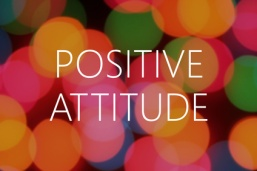 Positive Attitude text on colorful bokeh background